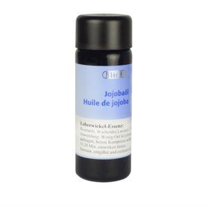 Das Jojobaöl ist in einer kleinen Flasche mit Tropfer. Das Etiket ist unten weiss, oben hellblau. Darauf ist der Name und die Produktbeschreibung.